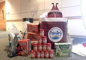 Donated items overflowing from the drop off during the employee holiday party.