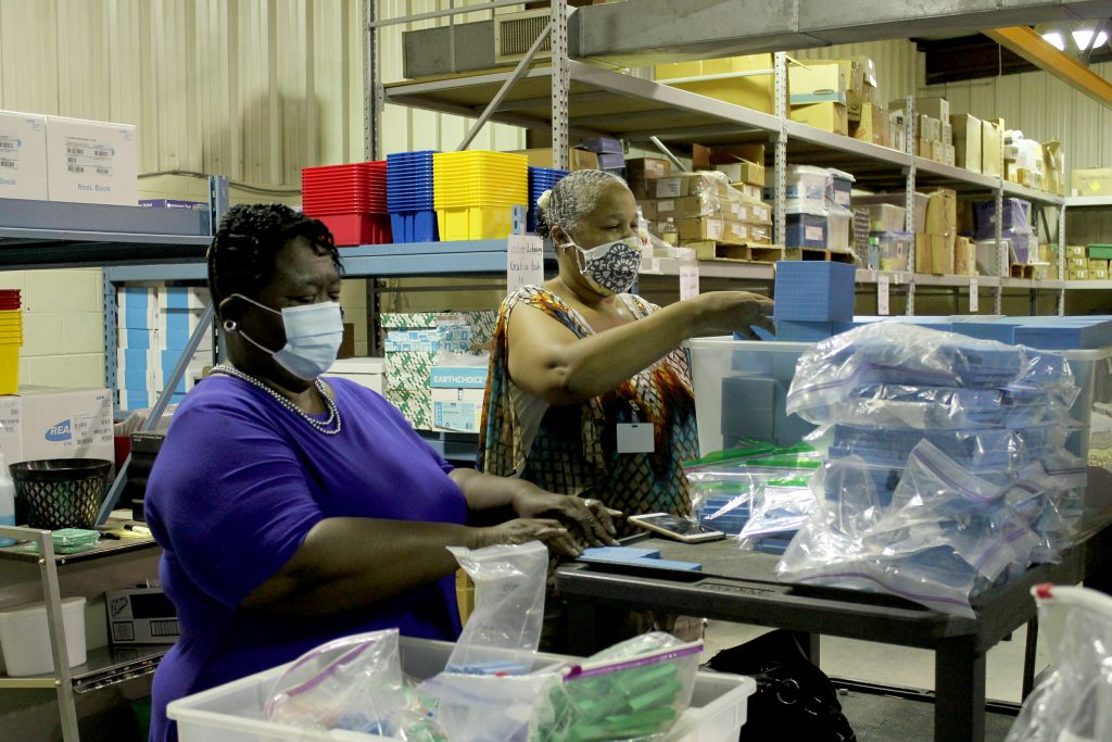 Dr. Little and Tonya Silas sort match pieces