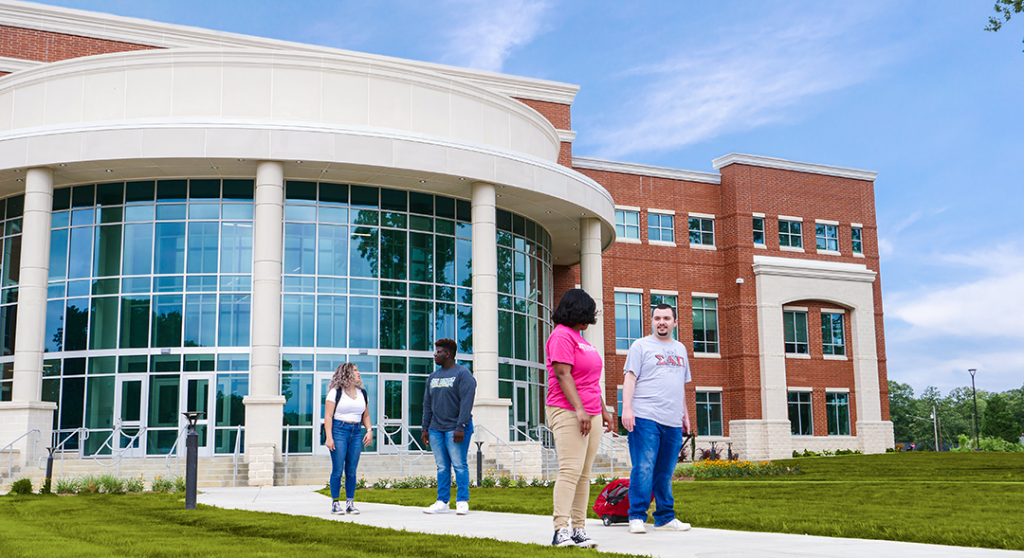 Students walking in front of the main building